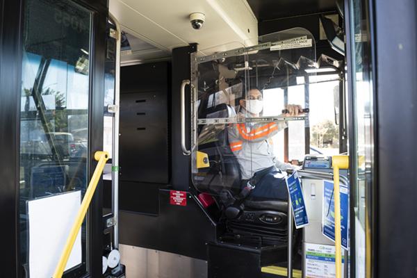 bus operator behind plexiglass