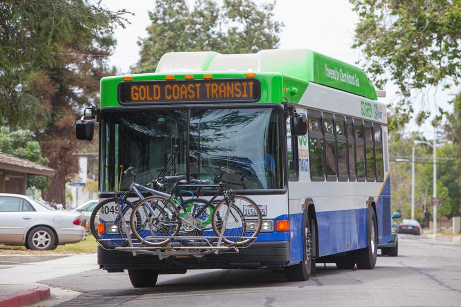 bus driving with bikes in the rack