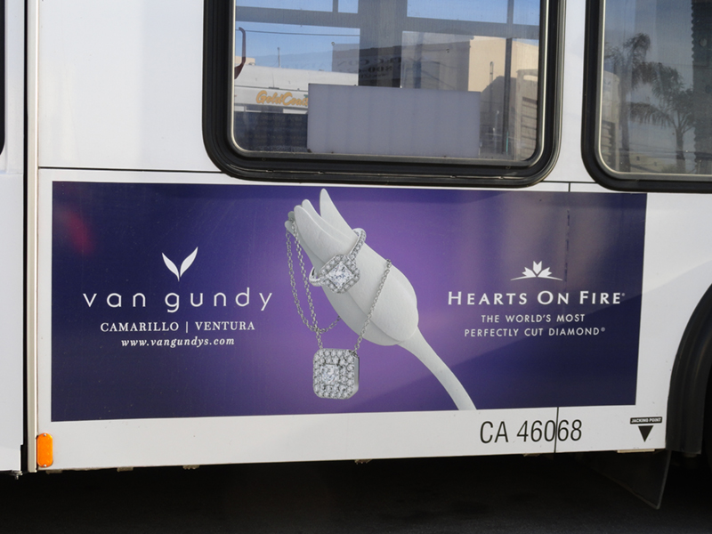 side of bus with ad poster