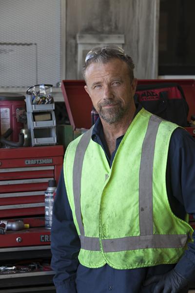 fleet maintenance employee in a construction vest